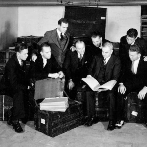 Illinois Band staff inspect the papers of John Phillip Sousa
